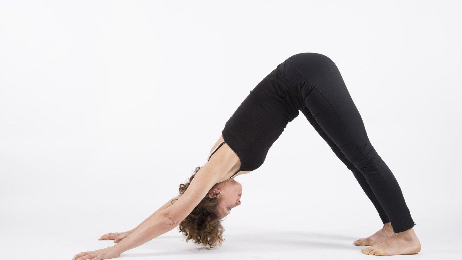Yoga posture adho mukha svanasana downward dog white background